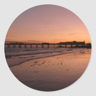 brighton pier in the sunset round sticker