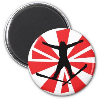 broken glas ski jump 6 cm round magnet