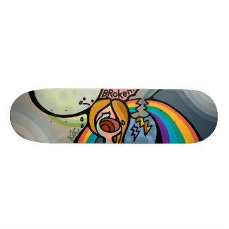 broken skateboard.