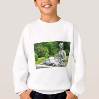 Bronze statue depicting woman sweatshirt
