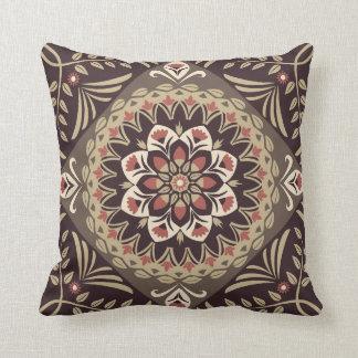Brown and tan mandala on throw pillow