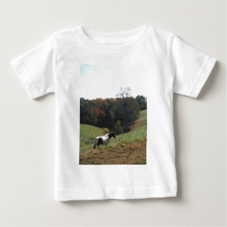 Brown and white horse at autumn pond tshirts
