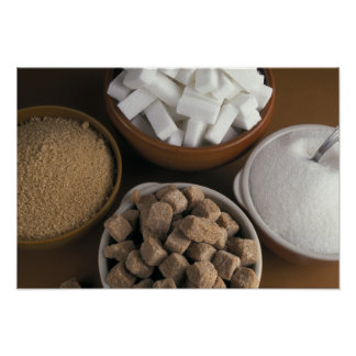 Brown and white sugars in cubes and powder poster