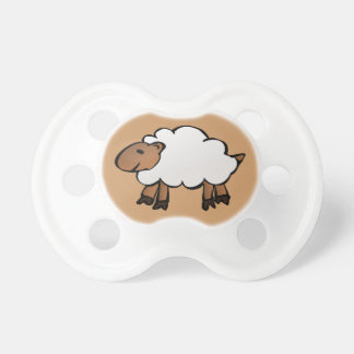 Brown baby dummy with a sheep pacifier