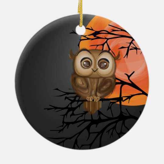 Brown baby owl on orange moon background round