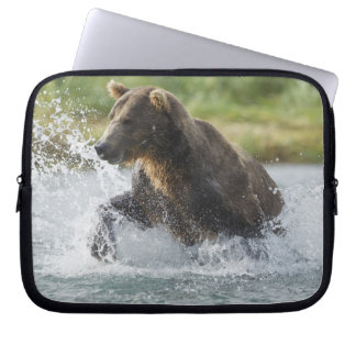 Brown Bear chasing salmon in river Laptop Sleeve