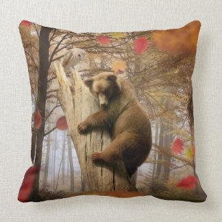 Brown bear climbing on tree cushion