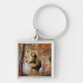 Brown bear climbing on tree key ring