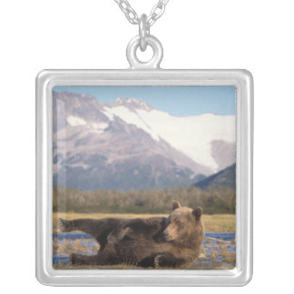 Brown bear, grizzly bear stretching on its back silver plated necklace