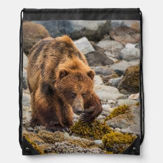 Brown bear on beach 3 drawstring bag