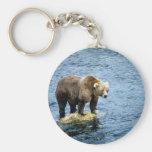 Brown bear on rock in river key chain