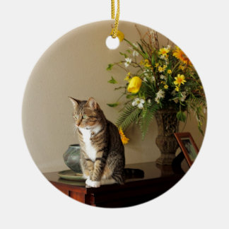 Brown black Tabby cat Sitting on piano flowers Round Ceramic Decoration