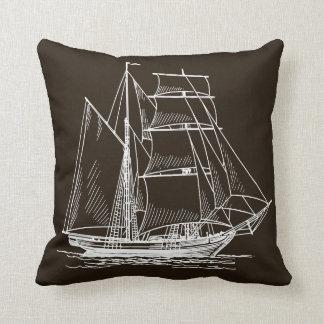 brown boat sailing ship pillow