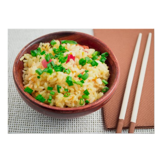 Brown bowl with a portion of cooked rice