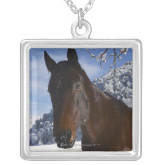 Brown horse in winter silver plated necklace