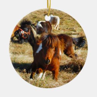 Brown miniature horses running christmas ornament