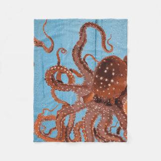 Brown Octopus on a Blue Wooden Board Fleece Blanket