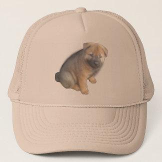 Brown Puppy show on a Trucker Hat