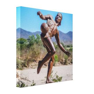 Brown Statue of Man kicking Futbol in Mexico Canvas Print