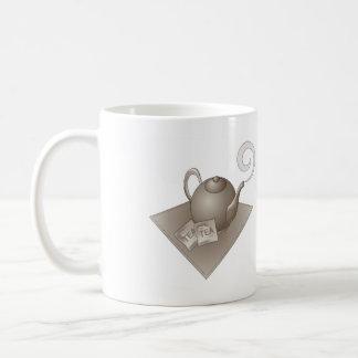 Brown teapot with teabags coffee mug
