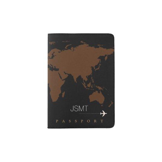 brown world map on black passport holder