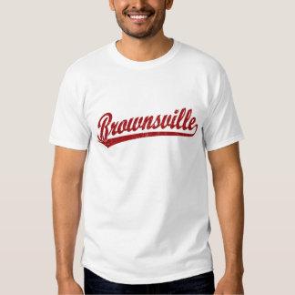 Brownsville script logo in red shirt