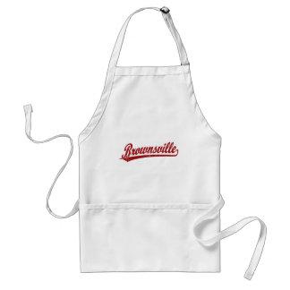 Brownsville script logo in red standard apron