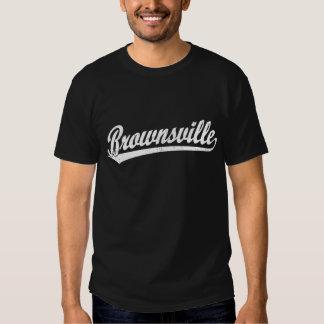 Brownsville script logo  in white tee shirt