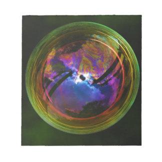 Bubble floating on Black background Notepad
