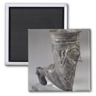Bucchero vessel in the form of a leg with sculpted square magnet