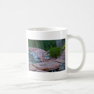 Buda meditating by the stream mug