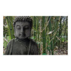Buddha figure with bamboo in the background poster