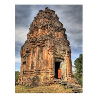 Buddhist monk standing in doorway of temple postcard
