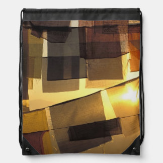 Buddhist prayer flags in the sunset, drawstring bag