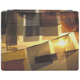 Buddhist prayer flags in the sunset, iPad cover