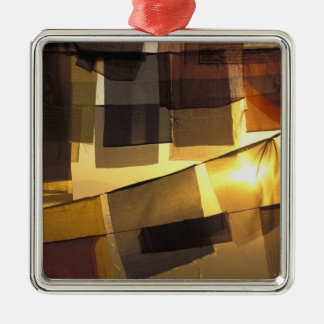 Buddhist prayer flags in the sunset, Silver-Colored square decoration