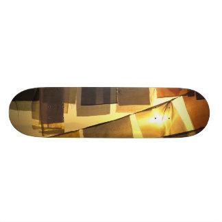 Buddhist prayer flags in the sunset, skateboards