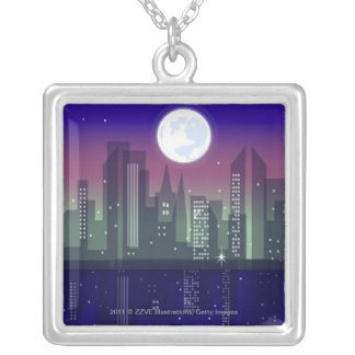 Buildings lit up at night silver plated necklace