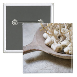 Bulbs of garlic in an earthenware bowl 15 cm square badge