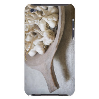 Bulbs of garlic in an earthenware bowl barely there iPod case