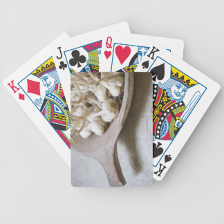 Bulbs of garlic in an earthenware bowl bicycle playing cards