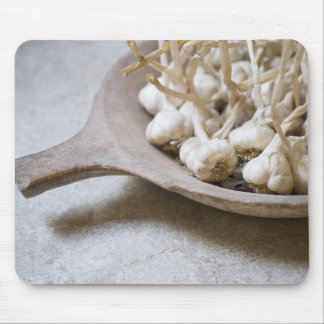 Bulbs of garlic in an earthenware bowl mouse mat