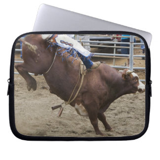 Bull rider at rodeo laptop sleeve