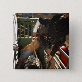 Bull rider tying rope on bull in the chute 15 cm square badge