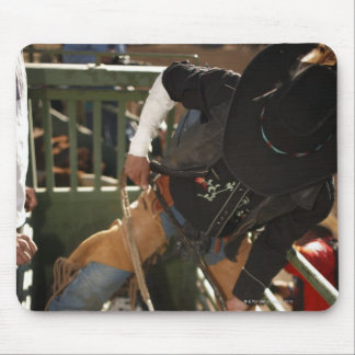 Bull rider tying rope on bull in the chute mouse pad