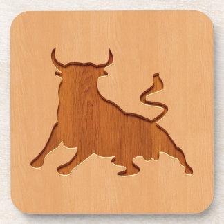 Bull silhouette engraved on wood design coaster