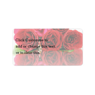 Bunch Of Rose Flowers And Their Reflection On The Address Label