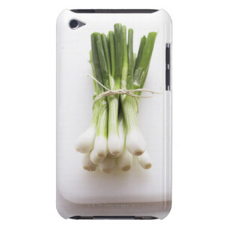 Bunch of spring onions on white chopping board iPod touch cases