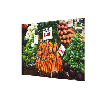 Bunches of carrots and vegetables on market stretched canvas print