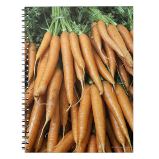 Bunches of carrots, full frame notebooks